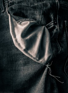 Empty pocket with tattered threads.